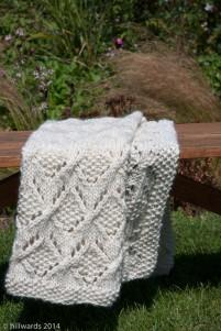 Chunky knit Umaro blanket draped